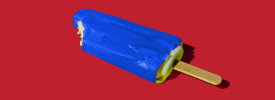 An electric blue ice lolly on a red background